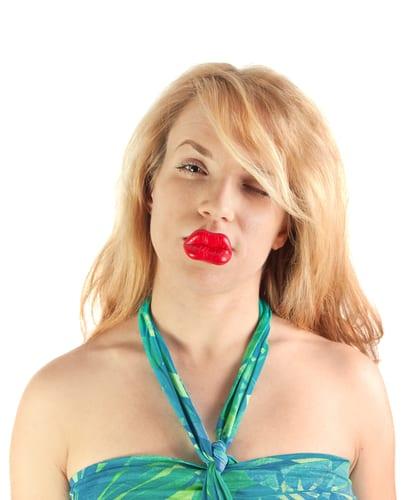Woman with big lips; plastic surgery metaphor