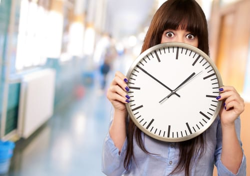 woman behind clock